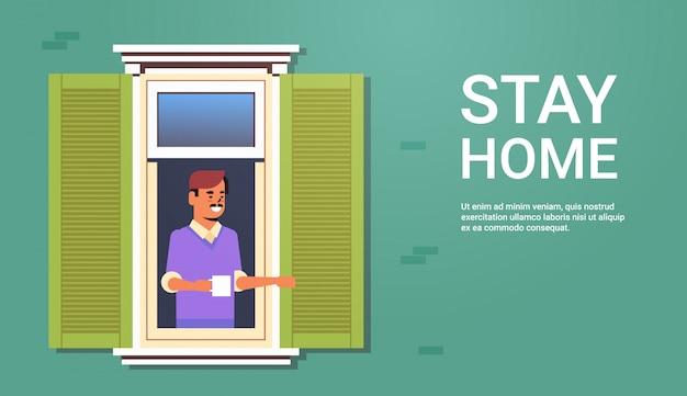 Man op zoek uit appartement blijven thuis zelfisolatie coronavirus pandemie quarantaine concept