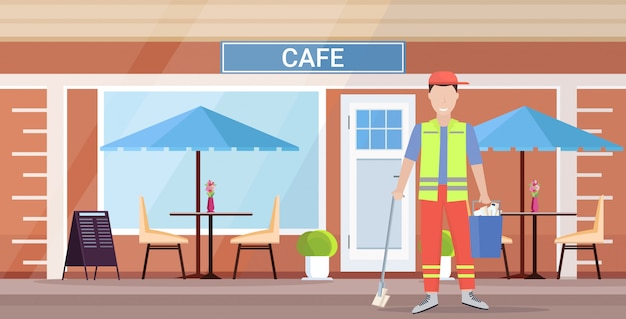 Man reiniger in uniforme emmer met voorraden en dweil mannelijke conciërge schoonmaak concept moderne stad straat café gebouw exterieur platte volledige lengte horizontaal