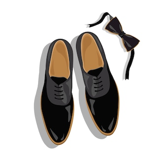Man schoenen en vlinderdas