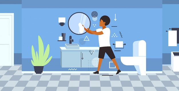Man schonere met behulp van vod afro-amerikaanse man schoonmaak spiegel doen huishoudelijk werk concept moderne badkamer interieur volledige lengte schets horizontaal