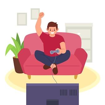 Man spelen van videogame op bank