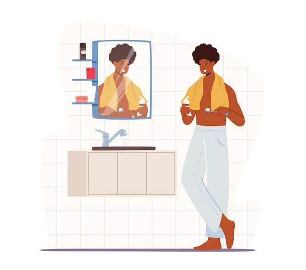 Man tanden poetsen. jonge knappe afrikaanse mannelijke karakter