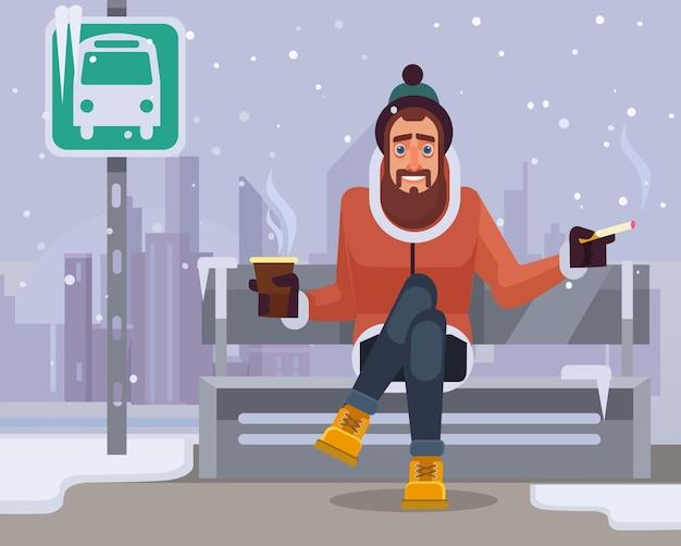 Man teken wachten op bus.