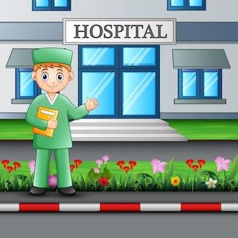 Man verpleegster staande voor ziekenhuis gebouw