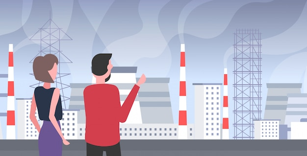 Man vrouw paar kijken naar plant pijp vuil afval giftig gas luchtverontreiniging industrie smog vervuild milieu concept mensen lopen buiten industrieel landschap horizontaal portret achteraanzicht