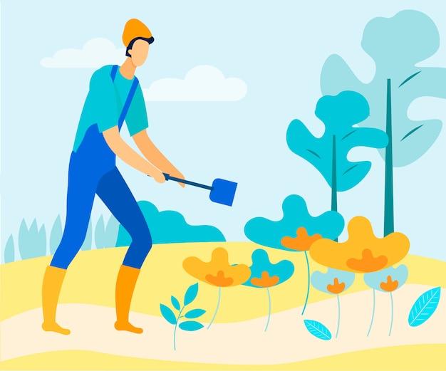 Man with garden spade staat in de buurt van flower beds