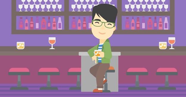 Man zit aan de bar.