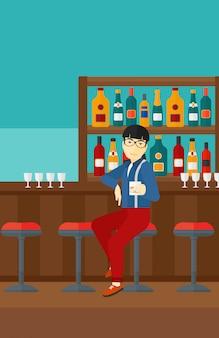 Man zit aan de bar