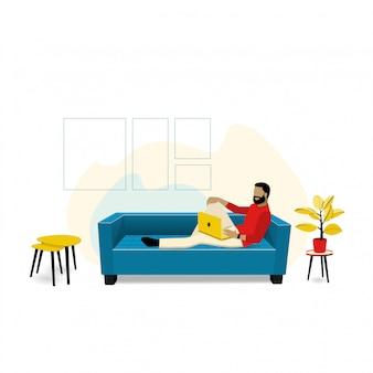 Man zittend op de bank in de woonkamer. ontspan of werk aan een comfortabele bank op avond of weekend thuis.