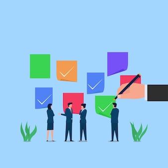 Manager en werknemer bespreken over het controleren van de taak