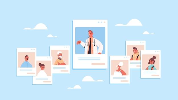 Mannelijke arts die familiepatiënten raadpleegt in vensters van de webbrowser online medische raadpleging gezondheidszorg geneeskunde