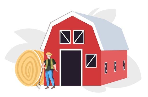 Mannelijke boer in uniform verzamelen hooi eco landbouw landbouw concept