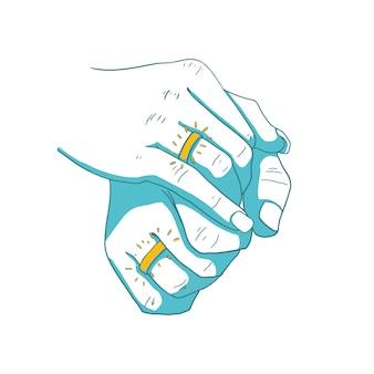 Mannelijke en vrouwelijke hand met ringen