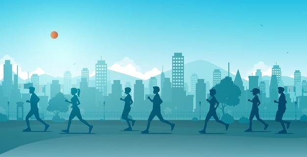 Mannelijke en vrouwelijke hardlopers die in georganiseerde marathons in de stad lopen.