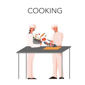Mannelijke en vrouwelijke restaurantchef-kok die maaltijd op de keuken kookt. heerlijk eten voor gasten. chef-kok bij het fornuis.