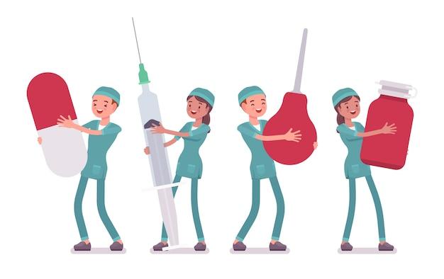 Mannelijke en vrouwelijke verpleegster met grote hulpmiddelen