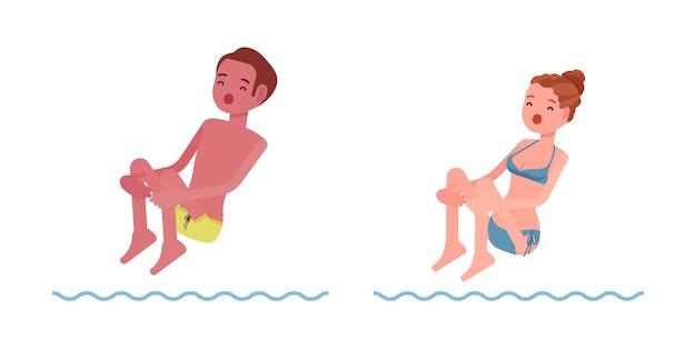 Mannelijke en vrouwelijke zwemmer die in waterset springen