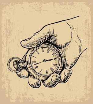 Mannelijke hand die de antieke hand van de zakhorlogegreep houdt