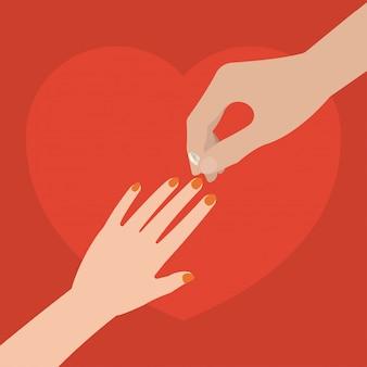 Mannelijke hand die trouwring op vrouwelijke hand zetten