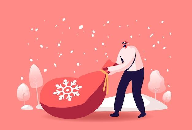 Mannelijke karakter in rode traditionele kerstman hoed trekt enorme zak met geschenken op besneeuwde landschap-achtergrond