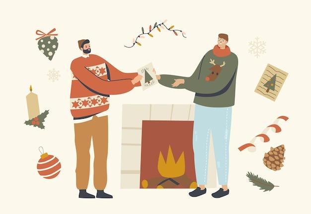 Mannelijke karakters veranderen kerstgroetkaarten in de buurt van open haard