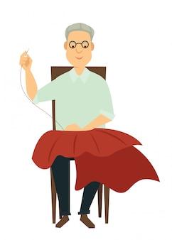 Mannelijke ontwerper naait rok met naald en draad