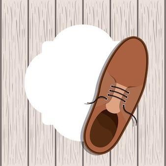 Mannelijke schoen over houten achtergrond