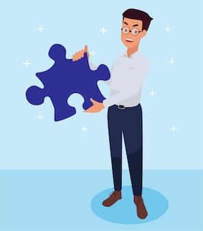 Mannelijke werknemer bracht een puzzel mee om de taak te voltooien.