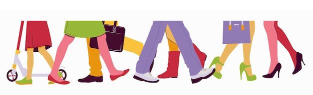 Mannen en vrouwen lopen in de menigte onderste lichaamshelft met benen en schoenen de weg oversteken