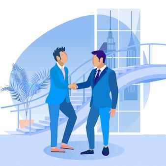 Mannen in blauwe pakken schudden elkaar de hand ealch other