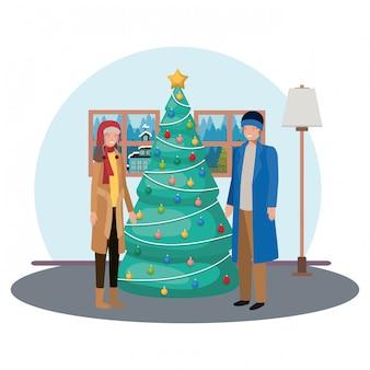 Mannen met kerstboom in de woonkamer