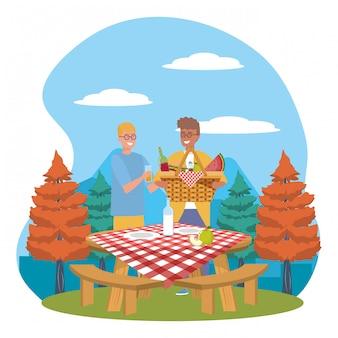 Mannen vrienden met picknick