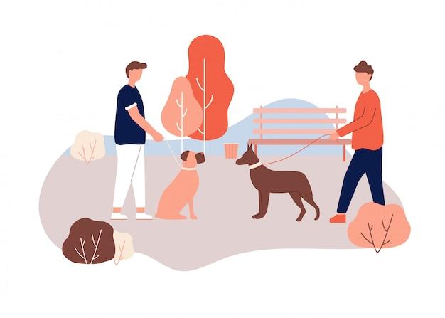 Manneneigenaar walk dog in park holding leash in hand