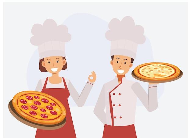 Mannetje en wijfje in professioneel uniform en chef-kokhoed met het houden van pizza