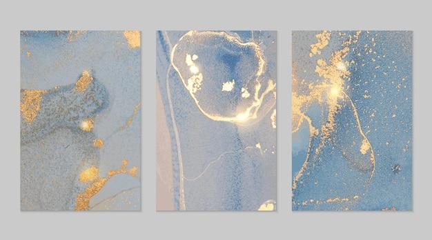 Marineblauwe en gouden marmeren abstracte texturen