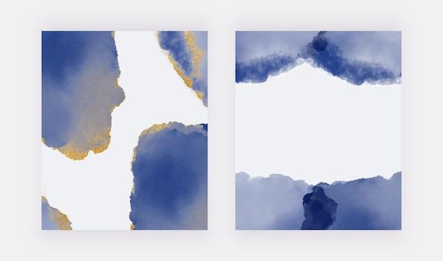 Marineblauwe penseelstreek aquarel met gouden glitter textuur achtergronden