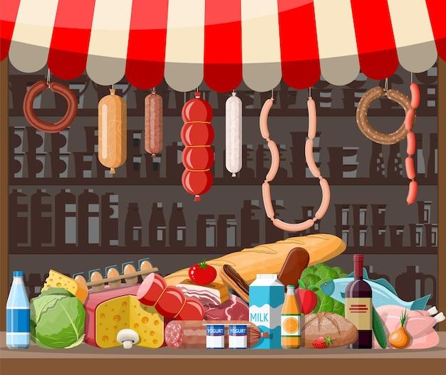 Markt winkel interieur met goederen. groot winkelcentrum. binnenwinkel binnen. kassa, kruidenier, drankjes, eten, fruit, zuivelproducten.