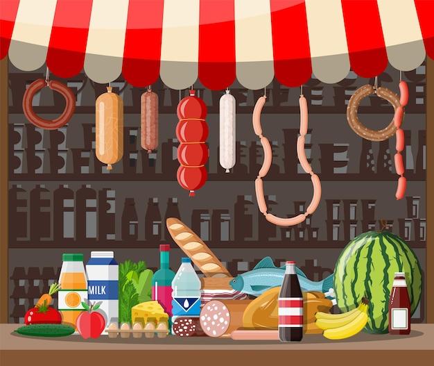 Markt winkel interieur met goederen. groot winkelcentrum. interieur winkel binnen. kassa, kruidenier, drankjes, eten, fruit, zuivelproducten. vectorillustratie in vlakke stijl
