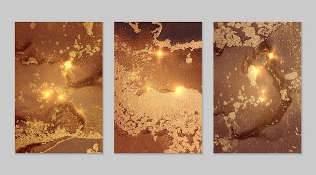 Marmeren set van fortuna goud en bruin abstracte achtergronden met glitter in alcoholinkttechniek