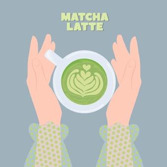 Matcha latte in een beker in vrouwelijke handen gezonde voeding concept
