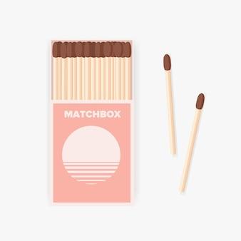 Matchbox van modern design en paar houten lucifers liggen ernaast geïsoleerd op een witte achtergrond.