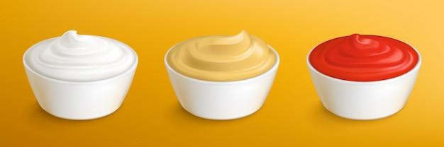 Mayonaise, mosterdsaus en ketchup in kommen