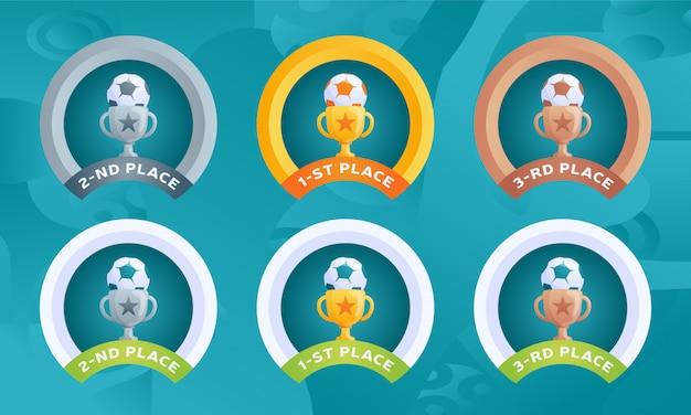 Medaillewedstrijden voetbal 2020 toernooi voor prijsplaatsen met een beker en een bal