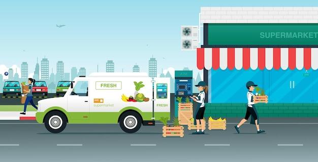 Medewerkers dragen verse groenten naar de supermarkt