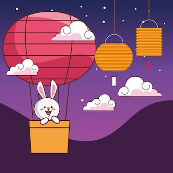 Medio herfst vieringskaart met klein konijn dat in hete hete lucht van de ballon reist