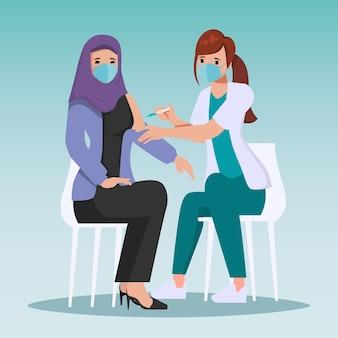 Medisch personeel is gevaccineerd tegen covid19 aan patiënt