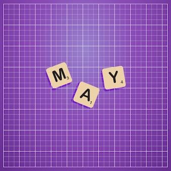 Mei maand in hoofdletters met scabbles blokconcept