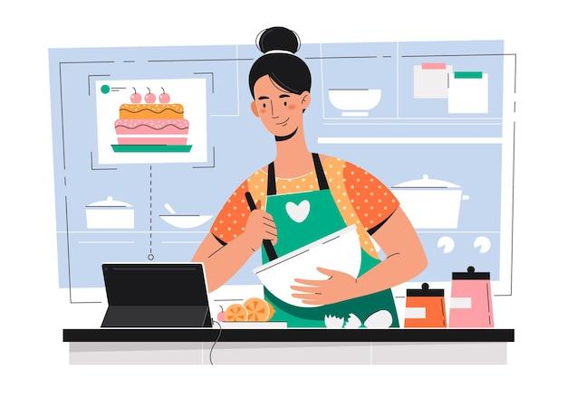 Meisje bereidt zich voor en kijkt naar de tablet. hobby thuis. thuis vrije tijd. jonge vrouw koken en met behulp van digitale tablet in de keuken.
