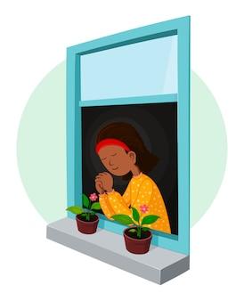 Meisje bidt in het raam