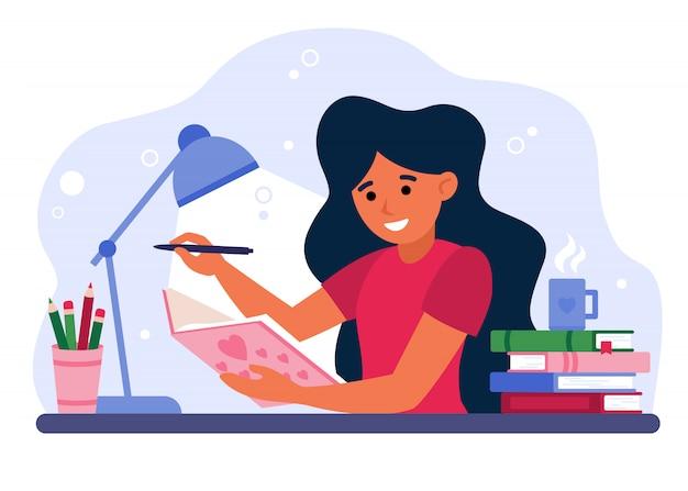 Meisje dat in dagboek of dagboek schrijft